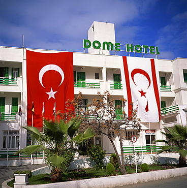 Dome Hotel with Turkish and Turkish Republic of Northern Cyprus flags, Kyrenia, Cyprus, Europe