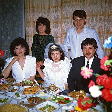 Uzbek bride and groom at wedding reception, Samarkand, Uzbekistan, Central Asia, Asia