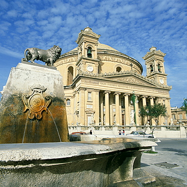 Lion on a fountain in front of the Rotunda church at Mosta, Malta, Europe