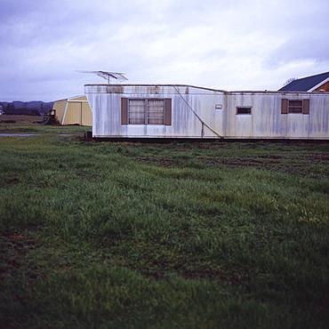 Trailer home with antenna on grassy lawn, Vashon Island, Washington State, United States of America, North America