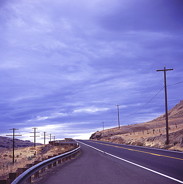 Empty road with power poles on both sides, Eastern Washington State, United States of America, North America