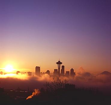 Sunrise over silhouette of Seattle skyline and Mt. Rainier, Seattle, Washington, United States of America, North America