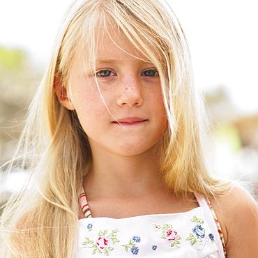 Girl (6-8) outdoors