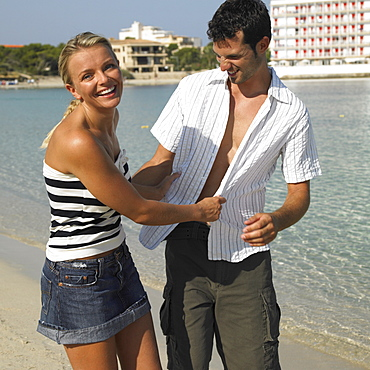 Coupleon beach, smiling
