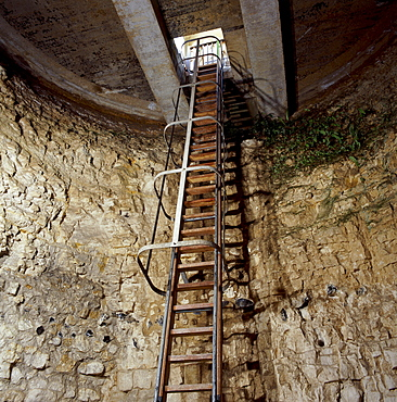 View of ladder down mine shaft, Neolithic flint mine, Grimes Graves, Norfolk, England, United Kingdom, Europe