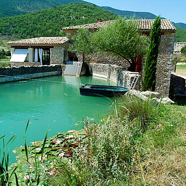 Drome river and renovated water driven olive mill house, Drome, Provence, France.