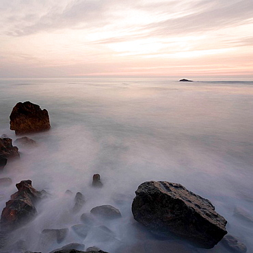 Sunset over coast, Porto, Portugal, Sunset over rocky coastline in Porto Oporto, Long exposure