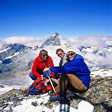 3 alpinists in front of the top of the Matterhorn, Zermatt, canton Valais, Switzerland