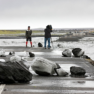 Boulders of Ice on road due to Jokulhlaup Glacial outburst, Iceland Glacial outburst flood from Myrdalsjokull, Iceland swept away a bridge over the Mulakvisi river The glacial flood or burst is a mixture of water, tephra, rock and ice floes
