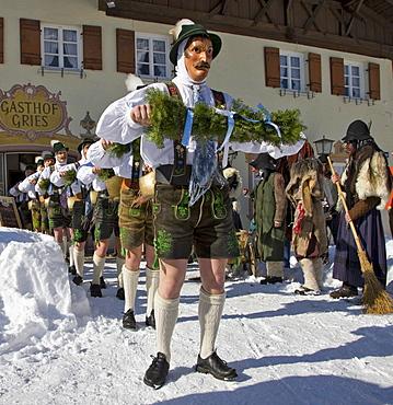 """Schellenruehrer"" bell ringers in front of the Gasthof Grieskirchen inn, carnival, Mittenwald, Werdenfels, Upper Bavaria, Bavaria, Germany, Europe"