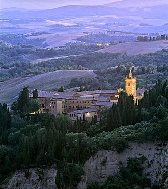 Abbey of Abbazia Monte Oliveto Maggiore at dusk, Crete near Chiusure, Asciano, Siena Province, Tuscany, Italy, Europe
