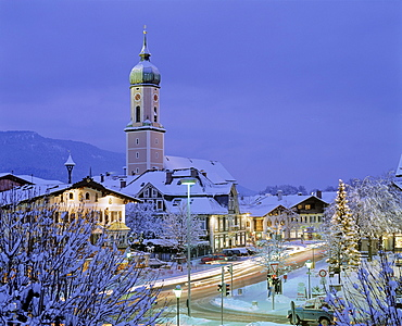 Church in Garmisch-Partenkirchen at dusk, Christmastime, Christmas tree in town square, Upper Bavaria, Bavaria, Germany, Europe