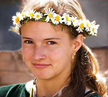 Portrait of girl dressed in traditional clothing at a medieval marketplace in Tallinn, Estonia, Europe