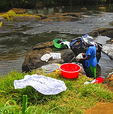 Laundry day by the river, Mauritius
