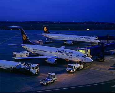 Lufthansa airplanes being loaded at night, Frankfurt International Airport, Frankfurt, Hesse, Germany, Europe