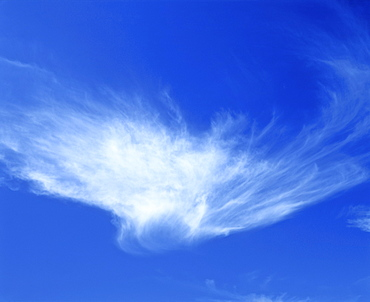Ghost-shaped cirrus cloud in a blue sky