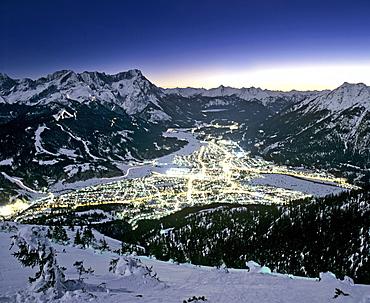 View from Mount Wank, night shot, Garmisch-Partenkirchen's town lights, Wetterstein Range, Werdenfels, Upper Bavaria, Bavaria, Germany