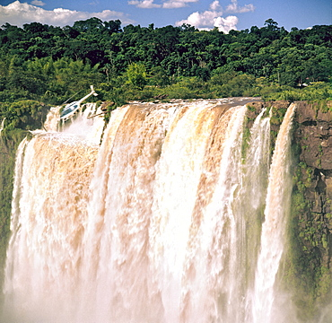 Helicopter over Iguazu Falls, UNESCO World Heritage Site, Argentina, South America