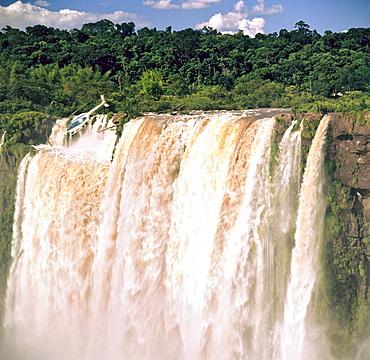 Helicopter over Iguazu Falls, UNESCO World Heritage Site, Argentina, South America