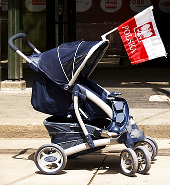 Polish flag attached to a baby carriage