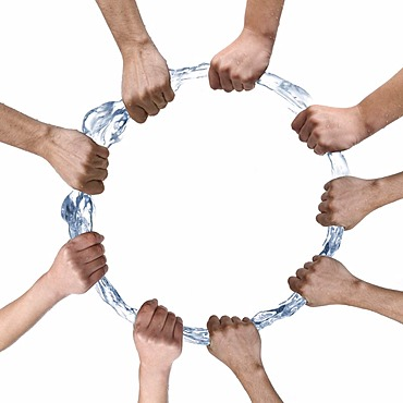 Several hands compass a ring of water