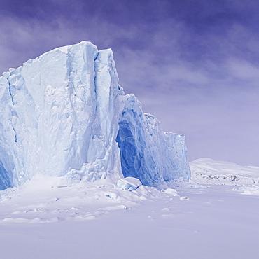 Iceberg in a frozen fjord, coast of Baffin Island, Davis Straight, Nunavut, Canada, North America