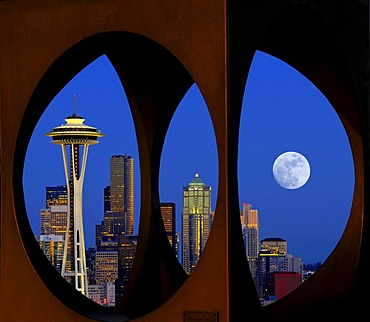 "Looking through the steel sculpture ""Changing Form"" by Doris Chase, Kerry Park, skyline of the Seattle financial district with Space Needle, full moon, Columbia Center, formerly Bank of America Tower, Municipal Tower, formerly Key Tower, U.S. Bank Center,"