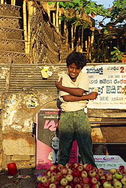 Teenage boy selling apples, Negombo, Sri Lanka, Asia