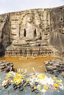 Seated Buddha statue with offerings, Polonnaruwa, Sri Lanka
