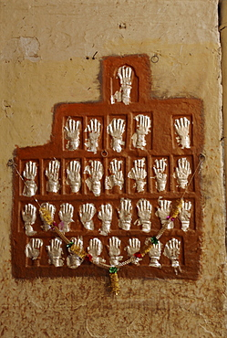 The handprints or Sati marks of ladies who died on the pyres, Jodhpur, Rajasthan, India
