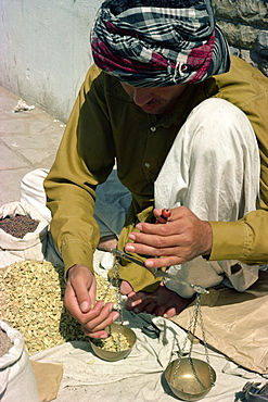 Man using scales, Karachi, Pakistan, Asia