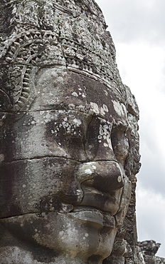 A smiling face carved in stone, Bayon, Angkor, UNESCO World Heritage Site, Siem Reap, Cambodia, Indochina, Southeast Asia, Asia