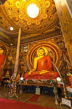 Large Buddhist statue at Gangaramaya Temple, Colombo, Sri Lanka, Asia