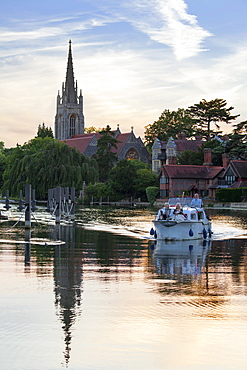 Group on boat with All Saints Church in the background, Marlow, Buckinghamshire, England, United Kingdom, Europe