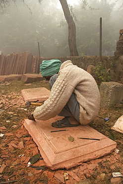 Stone mason carving relief for Taj Mahal repairs and restoration, Agra, Uttar Pradesh, India