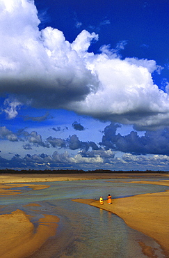 Monsoon clouds over almost dry bed of river Mayurakshi, West Bengal, India