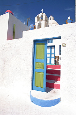 Blue and green door leading to pink steps at the entrance to a pension in Fira Town, the capital of Santorini (Thira), Cyclades Islands, Greek Islands, Greece, Europe