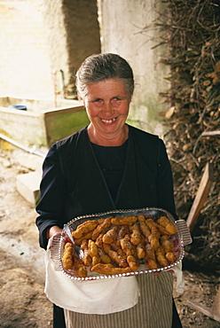 Lady with homemade churros, Lugo, Galicia, Spain, Europe