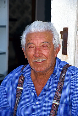 Portrait of a fisherman with a moustache, and wearing braces on Hvar Island, Croatia, Europe