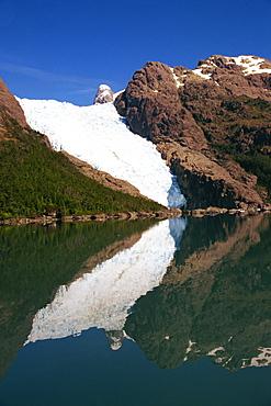 Reflections of a glacier in Chilean Fjordland, Magallanes, Chile, South America