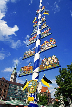 The maypole on the Viktualienmarkt in the city of Munich, Bavaria, Germany, Europe