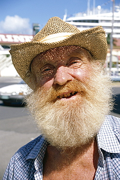 Head and shoulders portrait of an 'old timer', with beard and straw hat, Cairns, Queensland, Australia, Pacific