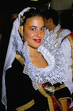 Portrait of a young woman in traditional folk costume, Cagliari, Sardinia, Italy, Europe