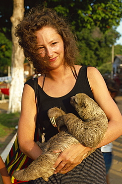 Lady cuddles three toed sloth, Alter do Chao, Amazon area, Brazil, South America