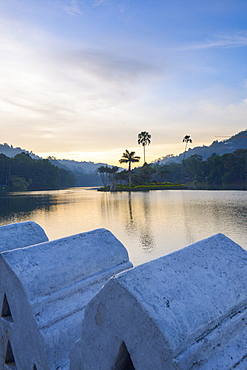 Kandy Lake at sunrise, the island of the Royal Summer House, with the Clouds Wall in the foreground, Kandy, Sri Lanka, Asia