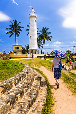 Tourist visiting Galle lighthouse in the Old Town of Galle, UNESCO World Heritage Site, Sri Lanka, Asia