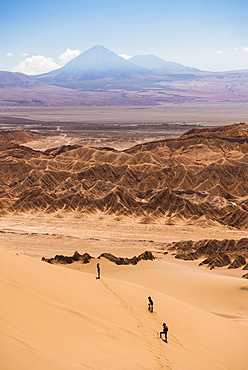 Tourists in sand dunes at Death Valley (Valle de la Muerte), San Pedro de Atacama, Atacama Desert, North Chile, Chile, South America