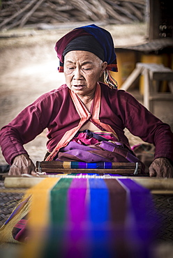 Palaung woman weaving, part of the Palau Hill Tribe near Hsipaw Township, Shan State, Myanmar (Burma), Asia