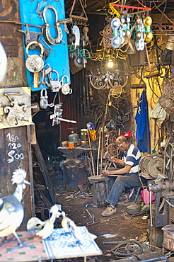 Carpenter and metalworker in his workshop in the souk, Old Medina, Marrakech, Morocco, North Africa, Africa