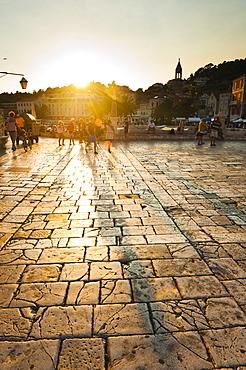 Tourists in St. Stephens Square at sunset, Hvar Town, Hvar Island, Dalmatian Coast, Croatia, Europe
